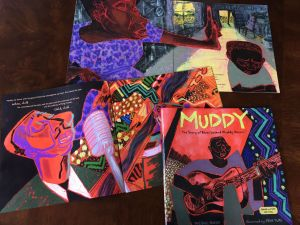 Table spread of images from my new book Muddy: The Story of Muddy Waters