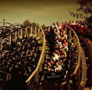 People dealing with the fears on a roller coaster ride.