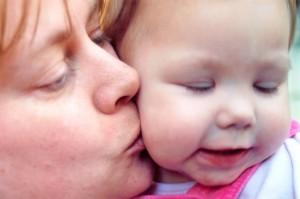 Mom Kissing Child