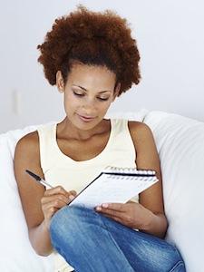 Woman Writing Goal List