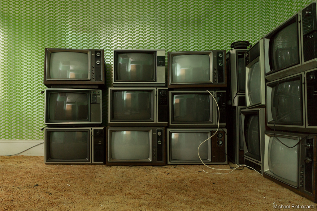 Stacked TVs at abandoned Adler Hotel, Sharon Springs New York