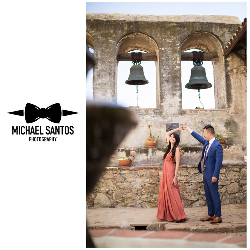 engaged couple dancing under the bells at their mission san juan capistrano engagement session