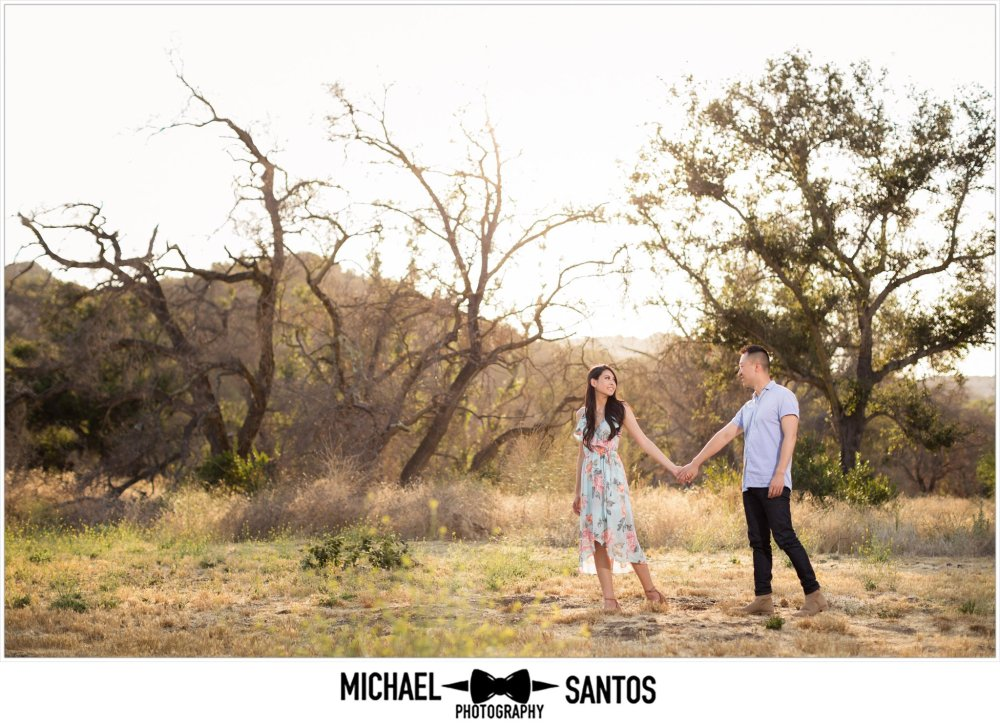 woman leading her fiance at their caspers wilderness park engagement photography session