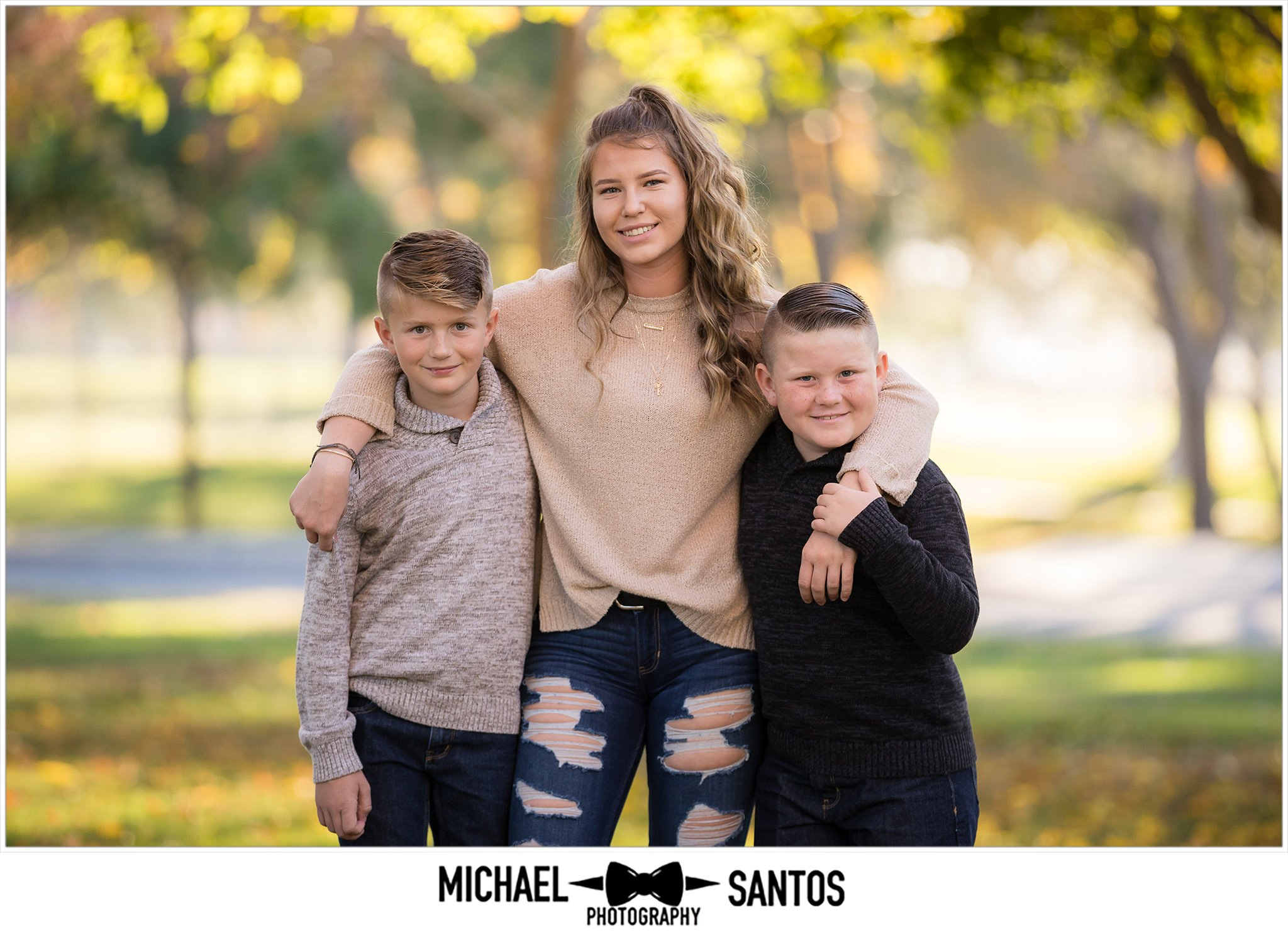 three kids hugging each other during their lancaster family photography shoot