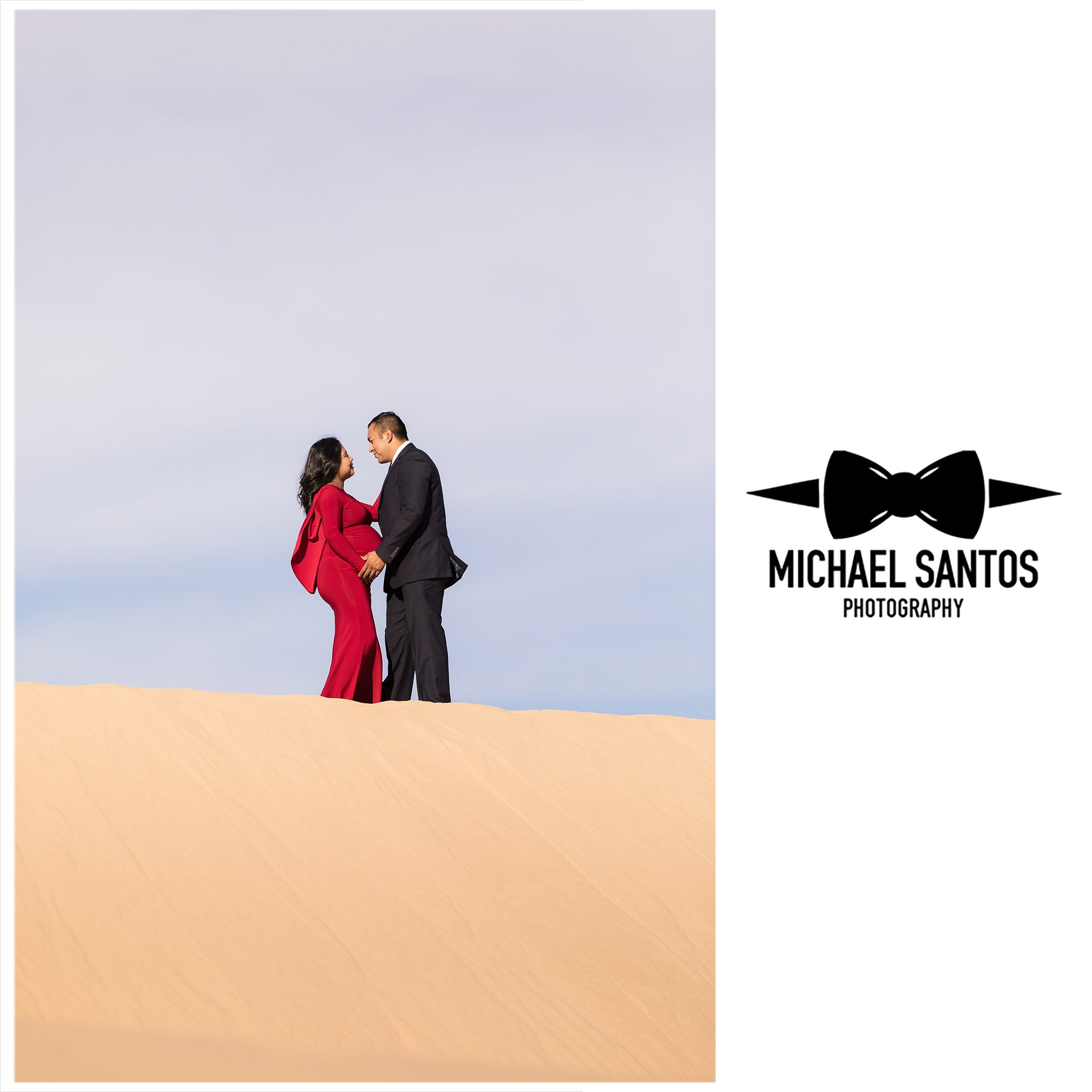 mother and father in formal attire during their sand dune maternity session
