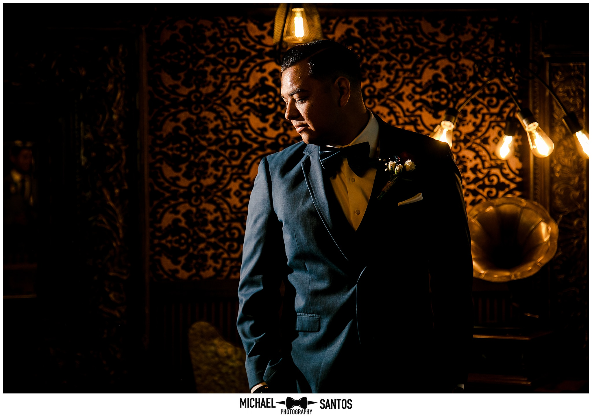 a dramatic photo of the groom in the grooms room at green gables wedding estate