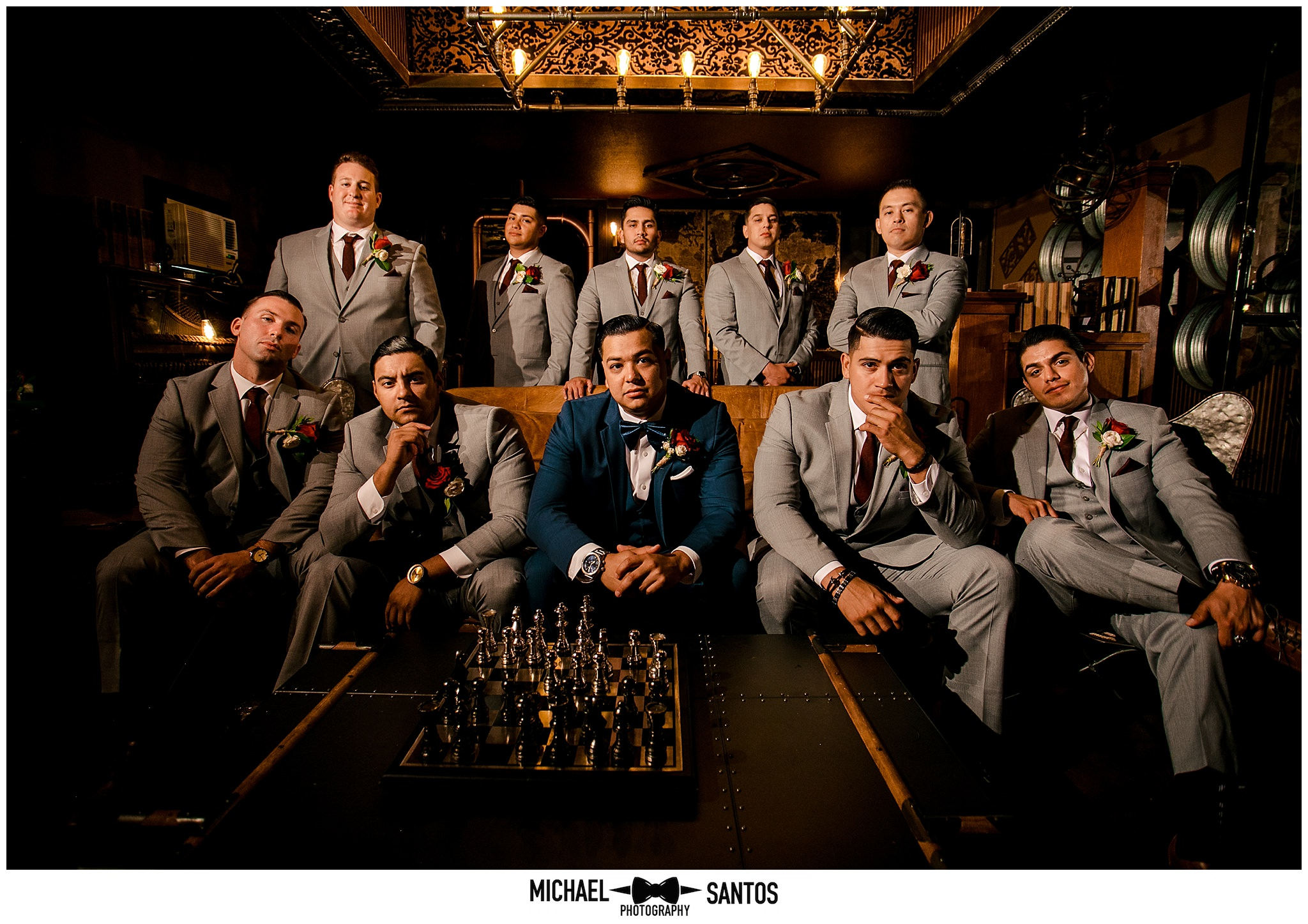 a dramatic group photo of the groom and his groomsmen in the grooms room at green gables wedding estate