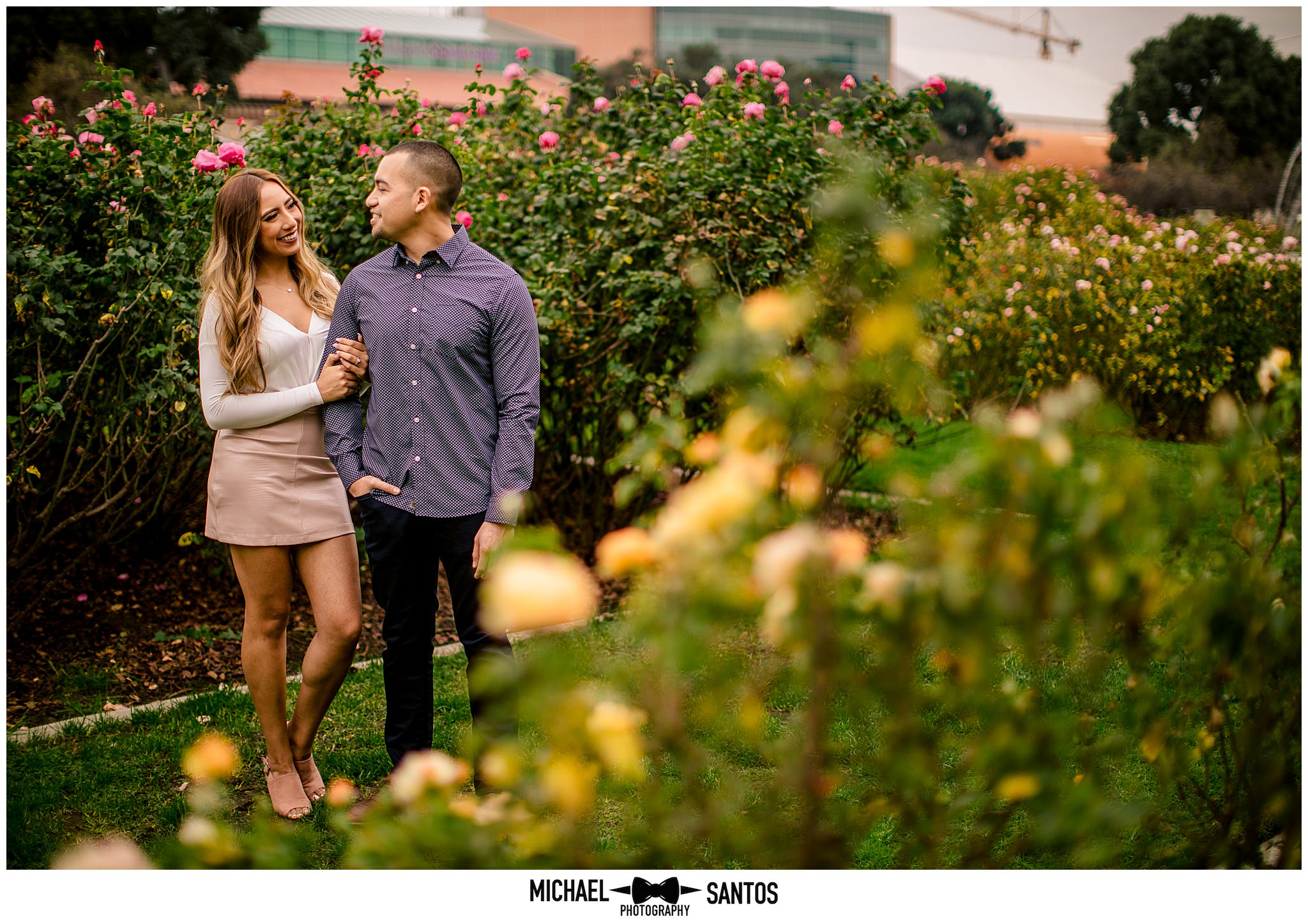 couple standing in the rose garden for their usc engagement photography