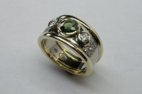 Lustrous contemporary style green sapphire and diamond ...