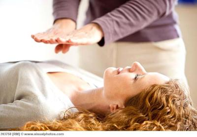 Cumberland Reiki Training - First Degree Reiki Training at Providence Zen Center - Providence Life Coaching Reiki Counseling - Woman receiving reiki treatment.