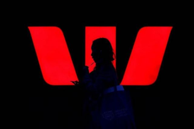 Westpac logo with man in shadows