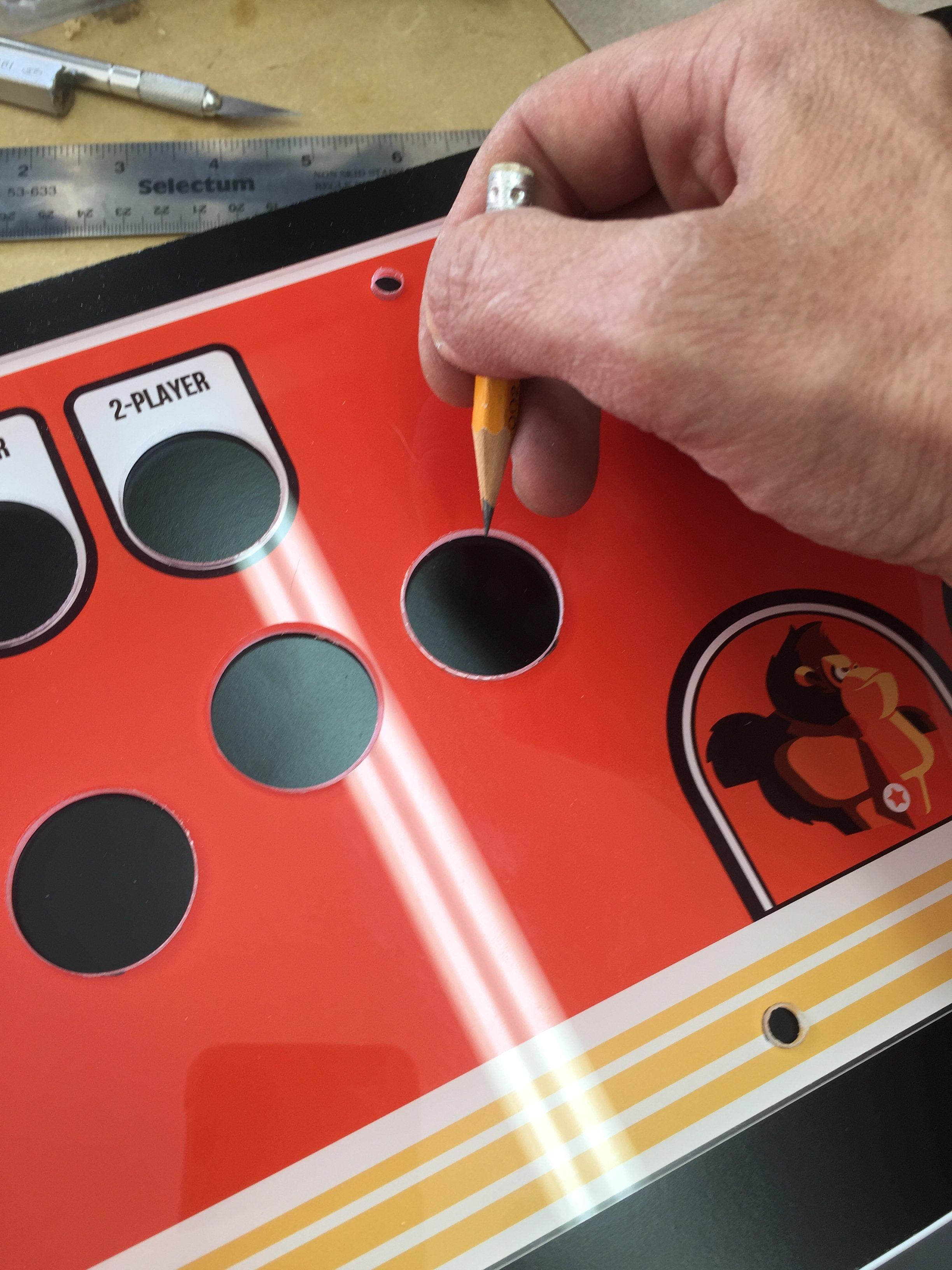 Donkey Kong Arcade Machine: Tracing Holes