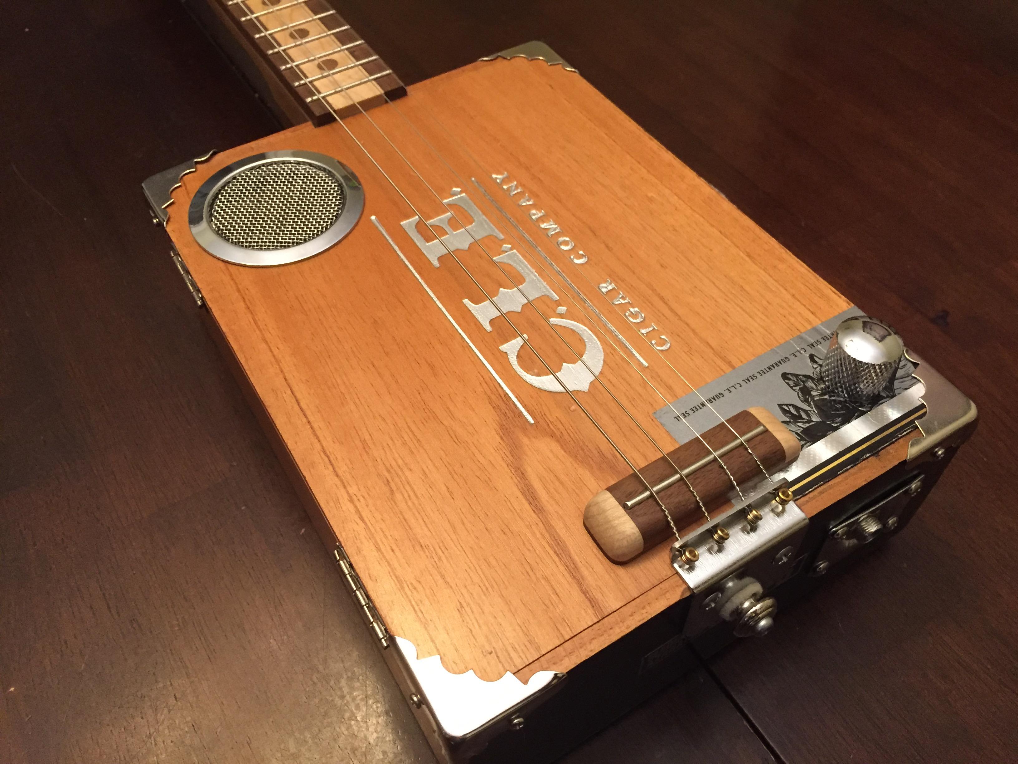 CLE Cigar Box Guitar Build - Custom bridge, tailpiece, v/c, sound-hole cover and corner details.