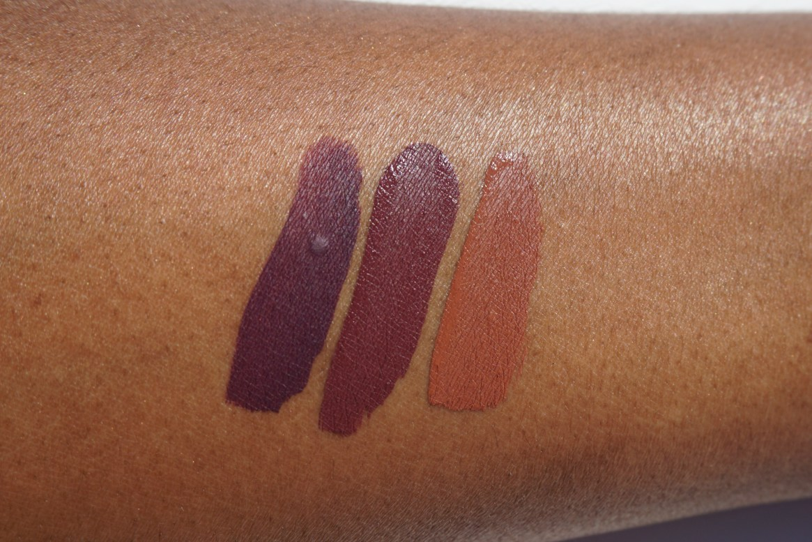 Give Me Glow Liquid Lipsticks swatches on brown skin Nude Beach, Cherry Cola, Bad Gal