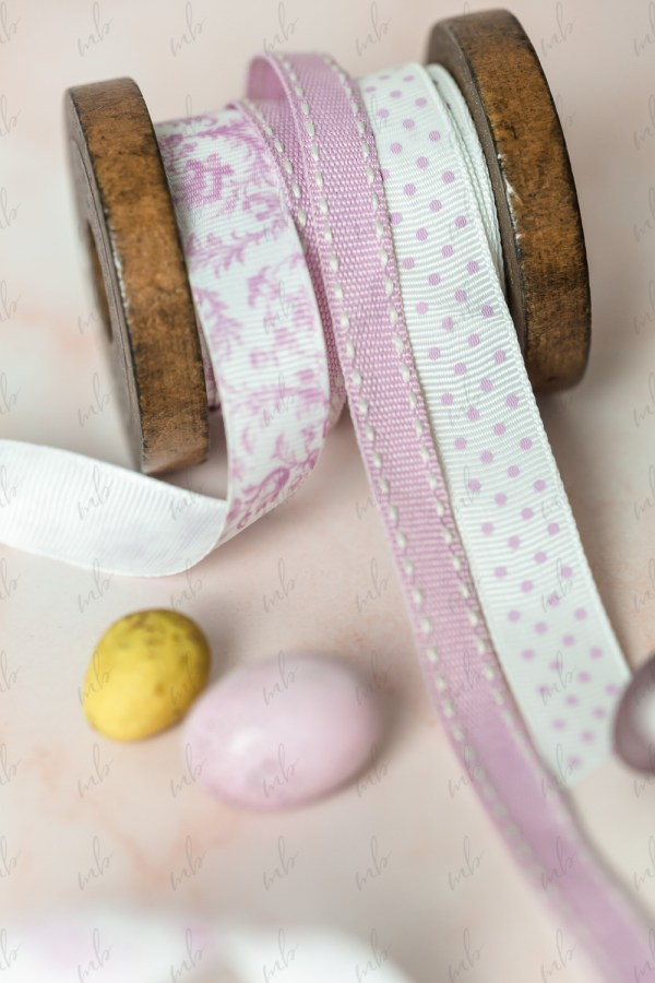 Easter stock photo. Pastel ribbon and mini easter eggs.