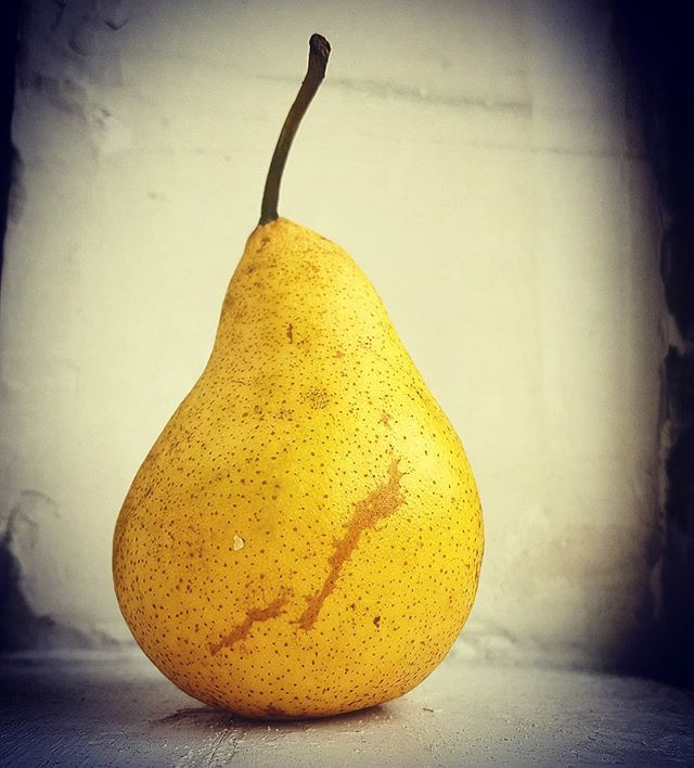 And then I ate it....#pear #autumn #food #foodphotography #fruit #yellow #windowlight #newyorkphotographer