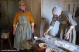 Interpreters demonstrate baking day.