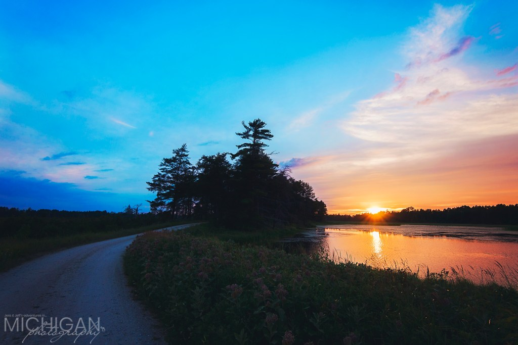 Seney National Wildlife Refuge - A view of the auto trail and the wetlands highlighted by the setting sun at Seney