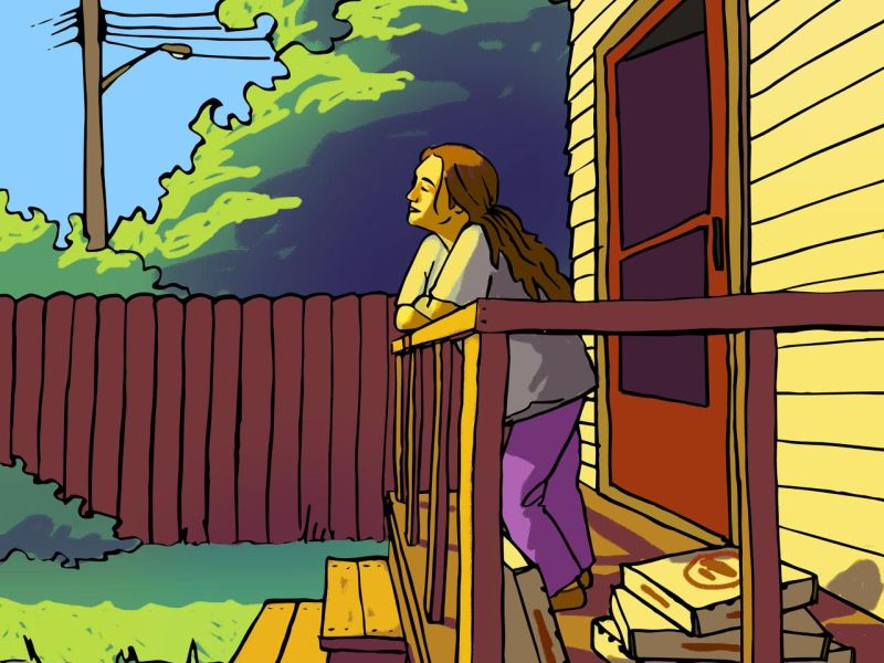A college-aged woman stands on a front porch looking toward the sun.