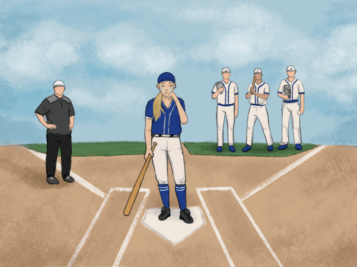 A female adolescent in a baseball crying in front of her coach and teammates.