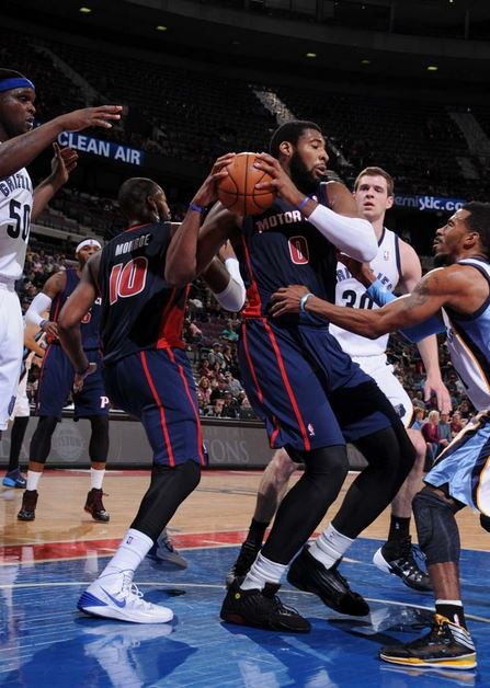 Andre Drummond fights for a rebound with Memphis' Mike Conley in the first quarter of Sunday's game at the Palace. The Grizzlies beat the Pistons, 112-84 (Photo courtesy of Allen Einstein/Detroit Pistons).