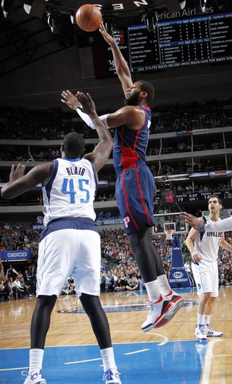 Andre Drummond shoots over DeJuan Blair of the Dallas Mavericks in Sunday's 116-106 loss. Drummond contributed a season-low four points and six rebounds in the game. (Photo courtesy of Glenn James/NBAE/Getty Images)