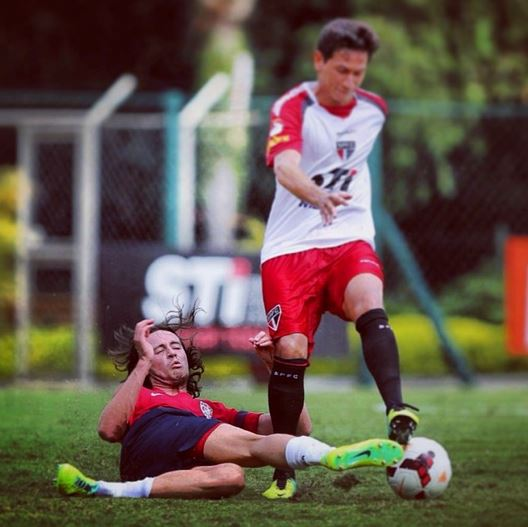 Mix Diskerud of the United States Men's Soccer team slides against a member of Sao Paulo FC on Thursday in a closed-door scrimmage. The U.S. lost 2-1, and will scrimmage Sao Paulo FC again on Monday (Photo Courtesy of Instagram - ussoccer)
