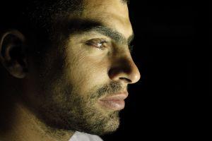 portrait-of-a-man-on-black-894578-m