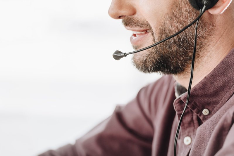 cropped shot of call center worker with microphone