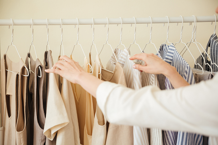 A women looking to buy bulk clothing cheap on a store