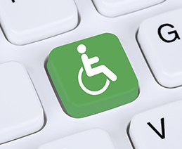 """Laptop key with """"International Symbol of Access (Wheelchair"""""""