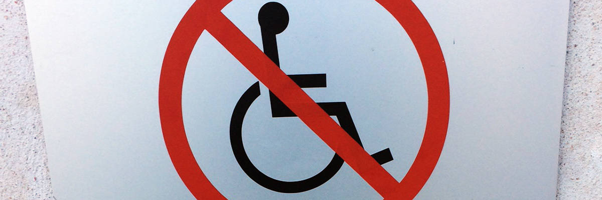 "Universal Symbol of Access on Sign with ""Do not"" symbol (circle and line) over it."