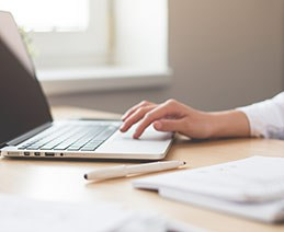 Businesswoman with fingers on laptop keyboard. Creating accessible elearning means building elearning so that it is perceivable, operable, understandable, and robust for individuals with disabilities.