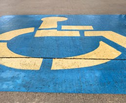 International Symbol of Access painted on a parking lot space.