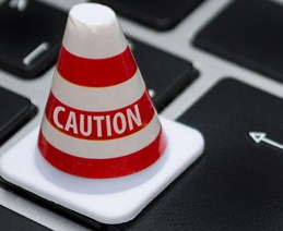 "Tiny ""Caution"" cone on laptop keyboard"