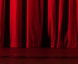 stage with red theater curtain