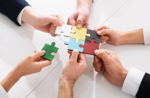 puzzle pieces coming together to represent how ehr mergers work