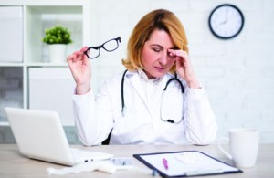 Female provider appears frustrated over reviewing HIPAA compliance information to avoid civil and criminal penalties for HIPAA violations