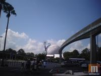 The Epcot wand being removed as seen from the parking lot