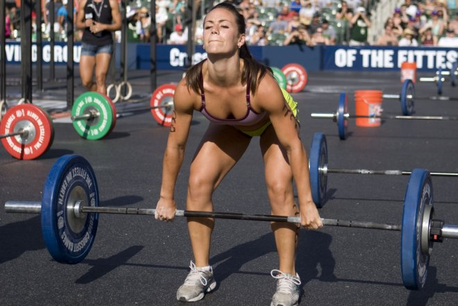 Cross Fit competition with Chrisw Camille about to do a deadlift motion