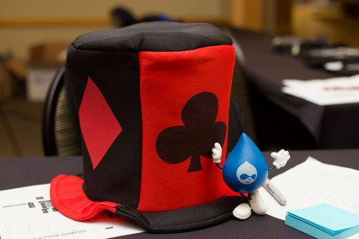 Black and red top hap with diamond and clubs design and Drupal drop figurine