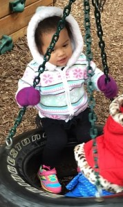 On the playground - She loves that tire swing!