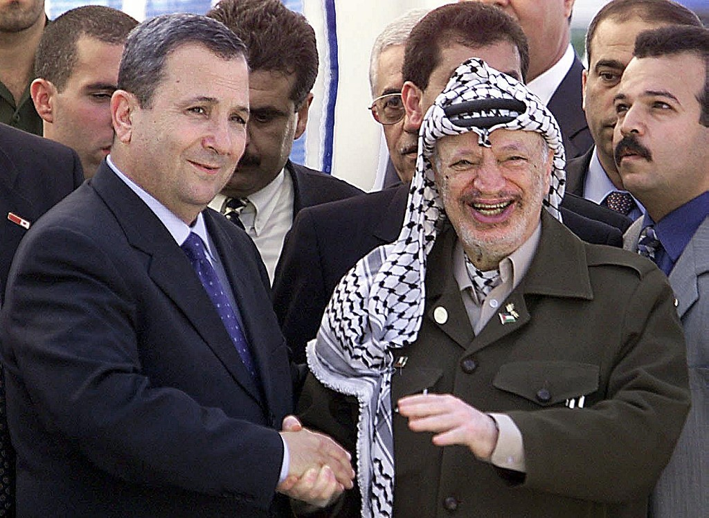 Then-Israeli Prime Minister Ehud Barak and then-Palestinian leader Yasser Arafat meet in 1999 (AFP)