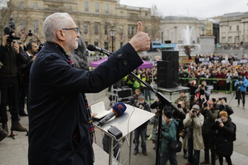 Corbyn speaks to anti-war demonstrators in central London on 11 January (AFP)