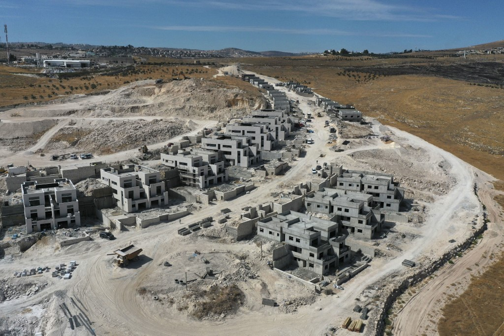 New houses are built in the Nokdim settlement in the occupied West Bank on 13 October (AFP)