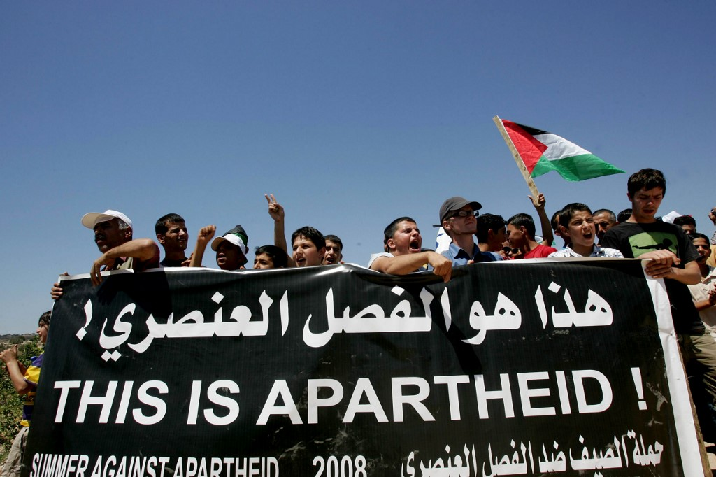 Protesters rally against the construction of Israel's separation wall in Jayus village in 2008 (AFP)