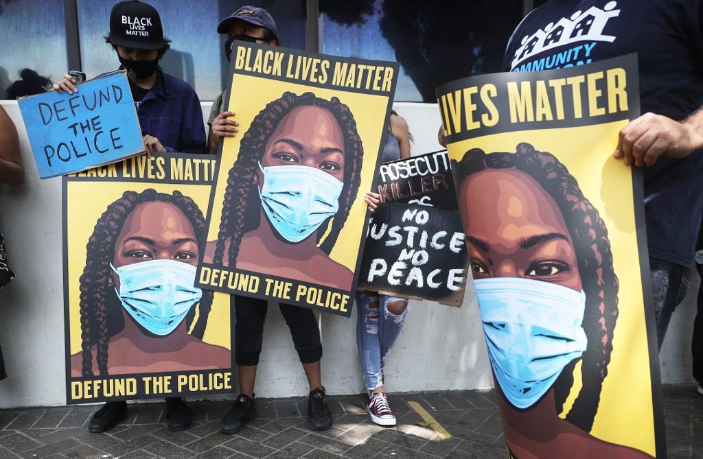 Black Lives Matter supporters protest in Los Angeles on 23 June (AFP)