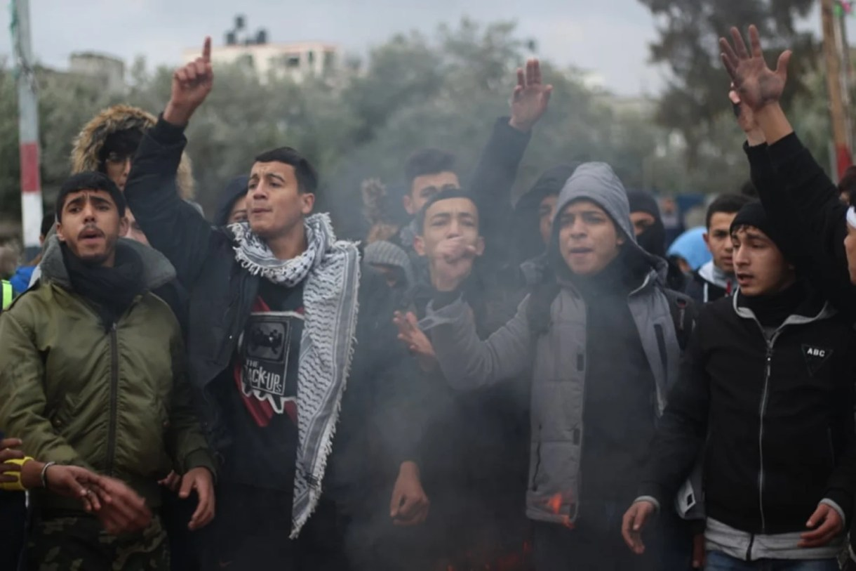 Palestinian high school students demonstrate calling for the return of their three classmates' bodies (MEE/Waleed Mosleh)