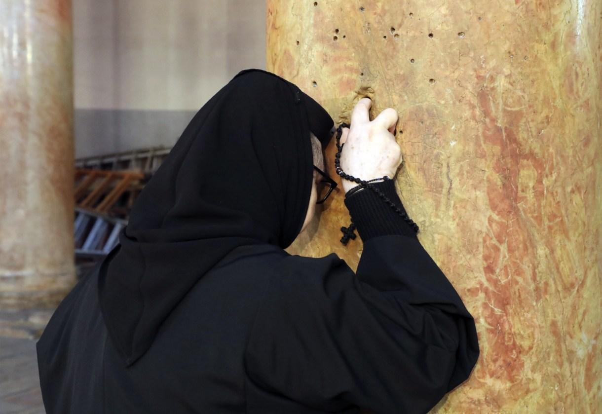 Nun praying Bethlehem