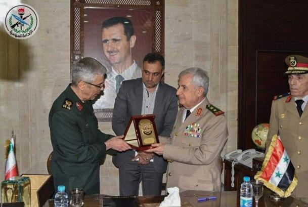 Major General Mohammad Bagheri and Syrian Defense Minister Ali Abdullah Ayyoub exchanging gifts after signing a bilateral military deal in the capital Damascus on 8 July (AFP photo/HO/SANA)